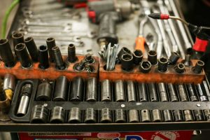 A tray of wrenches, wrench parts and tools in the shop at East Amazon Auto Repair in Eugene, Oregon