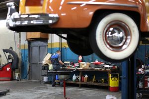 A mechanic preps materials to repair a vintage car at East Amazon Auto Repair in Eugene, Oregon